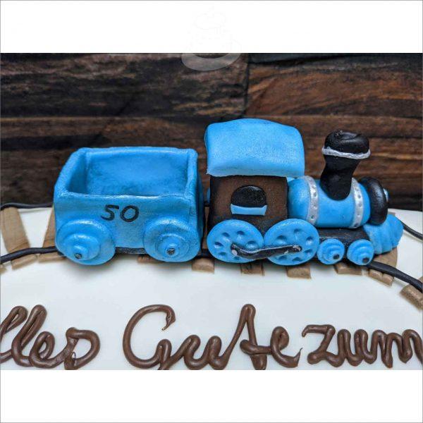 Eisenbahn/Zug/Lokomotive blau Eisenbahn Zug modellierte Figur Fondantfigur Tortenfigur Torte Torten Tuning Geburtstagstorte Suhl Hochzeitstorte Kindertorten Babytorten Fondant online