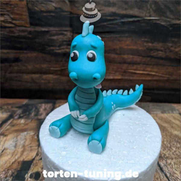 Tortenfigur niedlicher Dino